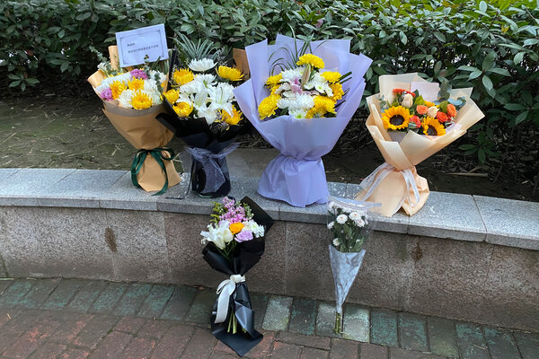 Floral tributes outside Wuhan Central Hospital in memory of Li Wenliang before the anniversary of his death. Dr. Li, one of the first to warn publicly about the coronavirus, died in the early hours of Feb. 7, 2020.
