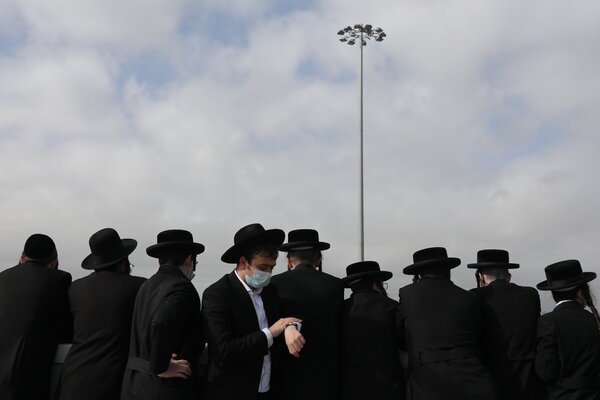 Ultra-Orthodox Jews at a funeral in Jerusalem last month. Organizations that help people leave ultra-Orthodox communities have noted a rise in demand for their services during the pandemic.