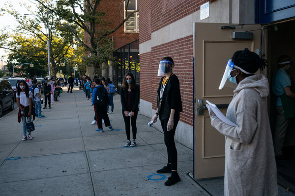 Students arriving for their first day of school at J.H.S. 157 in Queens in October. New York City closed its public schools the next month.