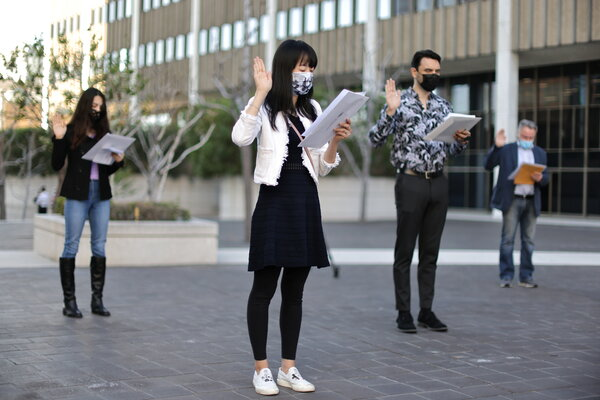An outdoor, socially distanced naturalization ceremony last week in Los Angeles. Trump administration tweaks to U.S. immigration policy have made it harder for applicants to obtain benefits.