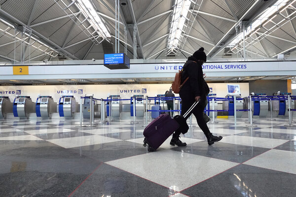 A traveler at O'Hare International Airport in Chicago this month. Passengers on international flights bound for the United States are required to show that they tested negative for the coronavirus.