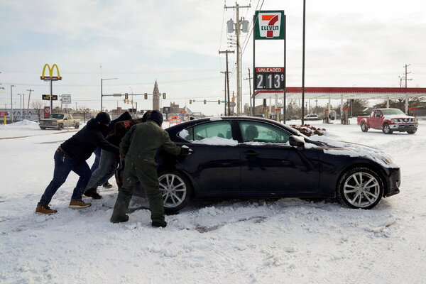 The storm is snarling travel across a wide region. People on Oklahoma City pitched in on Monday to help a stuck motorist.