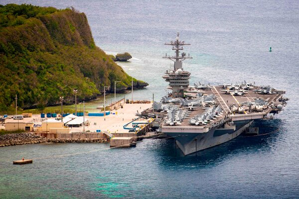 The U.S.S. Theodore Roosevelt moored at Naval Base Guam last summer.