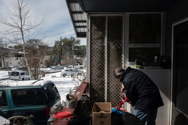 Joel Zavala refilled a generator Tuesday at his Austin, Texas, home, which had been without power since early Monday morning. The authorities warn against running cars or generators indoors to stay warm.