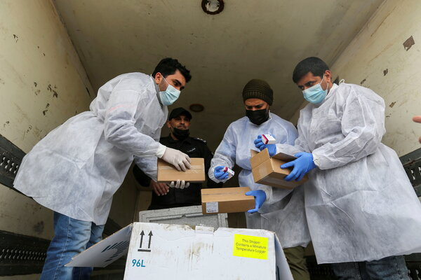 Palestinian health workers unloading the Gaza Strip's first shipment on Wednesday.