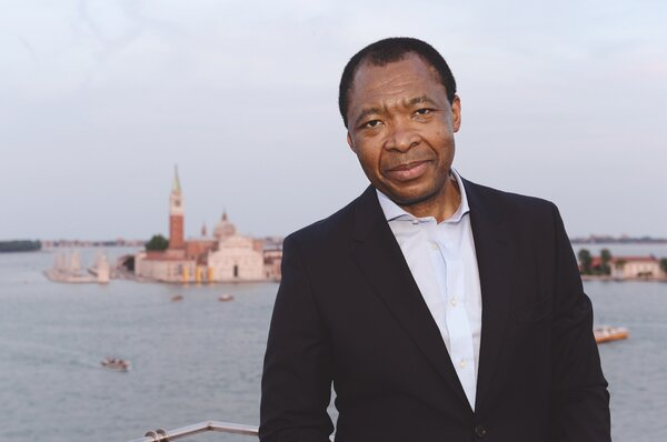 Okwui Enwezor, a renowned Nigerian-born curator, died before his show — a moral broadside —  could be completed. It was realized by a team of four curators.