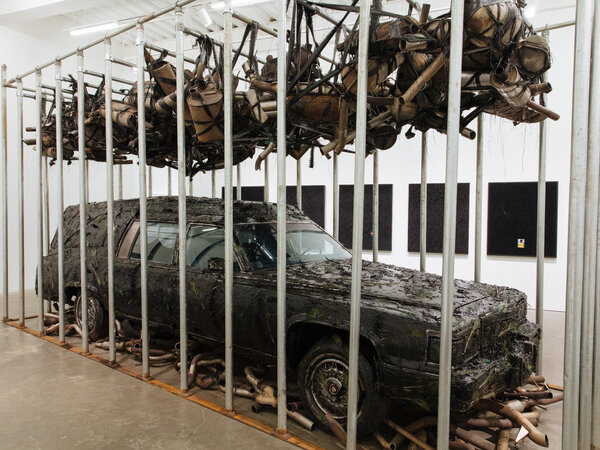 "Nari Ward's installation ""Peace Keeper"" (1995; recreated 2020) is a hearse encased in tar and feathers, in ""Grief and Grievance: Art and Mourning in America."" The funerary work, set inside a cage at the New Museum, suggests commemoration, but also humiliation."