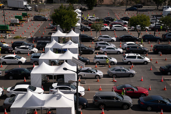 Motorists lined up for a Covid-19 shot at a mass vaccination site in Los Angeles this month.
