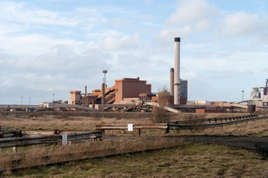 Plans to build an electric plant near a former steel mill include equipment to remove carbon dioxide from the plant's exhaust.