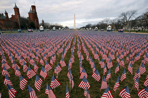 Thousands of U.S. flags at the National Mall in January, as part of a memorial paying tribute to Americans who have died from the coronavirus.