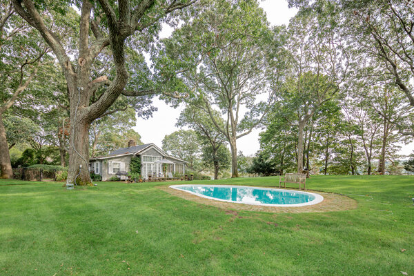 A free-form pool divides Midway into a 1.8-acre property.  Steinbeck family members called it