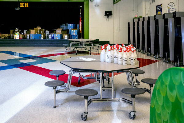 Bottles of disinfectant sit on a table at Hickory Hills Elementary School in Marietta, Ga.