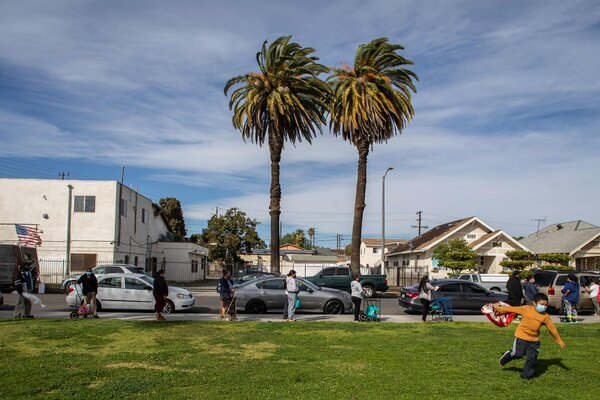 People wait in line at a food distribution center in South Central Los Angeles earlier this month.