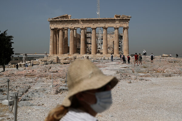 The Acropolis archaeological site in Athens reopened to visitors in May. Greek officials are hoping to bolster the tourism industry with vaccination certificates.