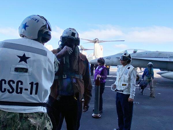 Defense Secretary Lloyd J. Austin III greeting troops aboard the carrier Nimitz on Thursday.