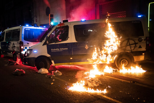 A police van set on fire in Barcelona on Saturday by protesters demonstrating against the arrest of the rapper Pablo Hasél.