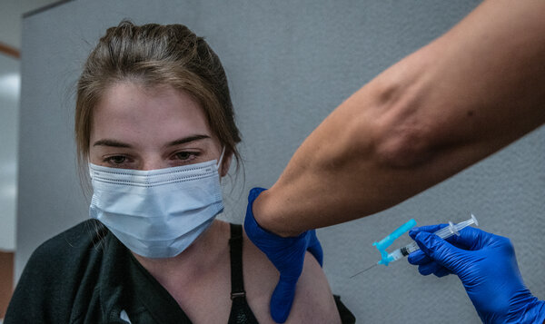 Alyssa Jost, 19, received her second dose of the Moderna vaccine at Cobre Valley Regional Medical Center in Gila County, Ariz.