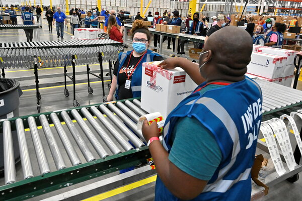 The first boxes of the Johnson & Johnson vaccine coming off the conveyor at the McKesson facility in Shepherdsville, Ky., on Monday.