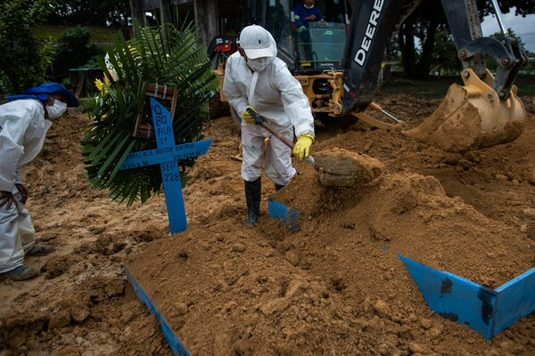 A funeral on Monday in Manaus, Brazil, for a person who died of Covid-19. A variant from Brazil, P.1, is a new worry for scientists.