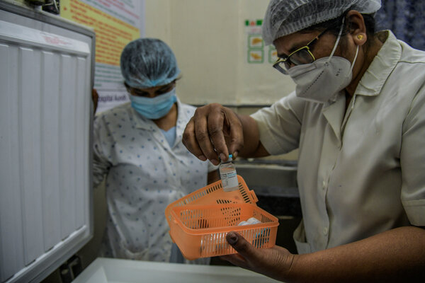 Handling the Covaxin vaccine in Pune, India, before the country's vaccine rollout in January.