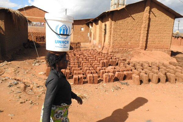 A woman walking through the Dzaleka Refugee Camp in Malawi in 2018.