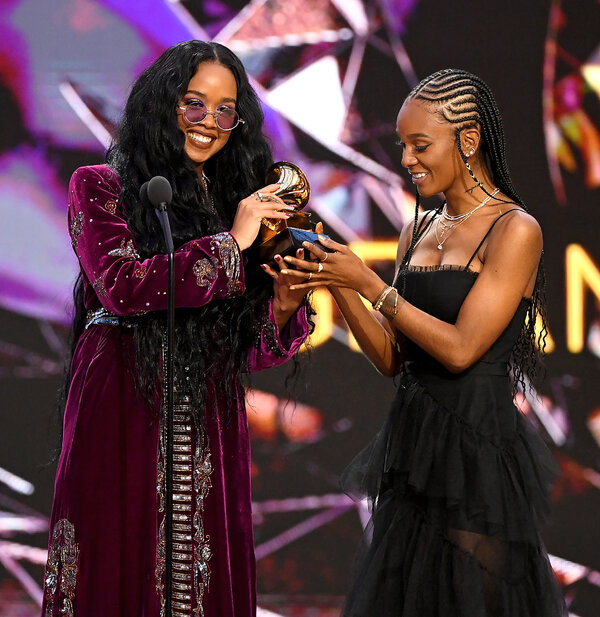"""H.E.R., left, and Tiara Thomas accept the song of the year Grammy for """"I Can't Breathe."""""""