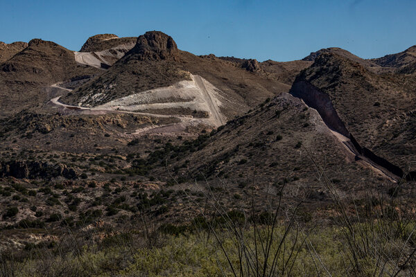 In some places along the border, such as Guadalupe Canyon in southeast Arizona, dynamiting crews were blasting hillsides on Inauguration Day.