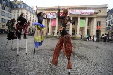 Performers in front of the Odéon Theater in Paris, which workers have occupied since March 4.