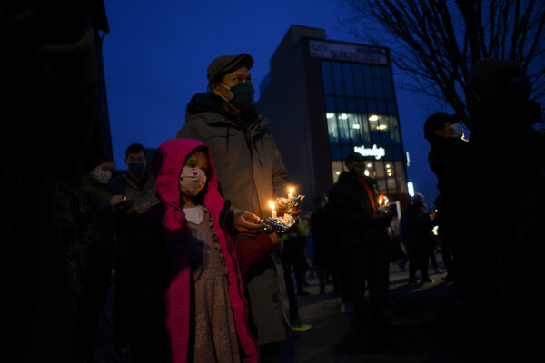 Victor Shey and his daughter AnnaLene Shey, 7, attended a vigil in Queens, N.Y., on Wednesday for the victims of a shooting in Georgia, six of whom were women of Asian descent.