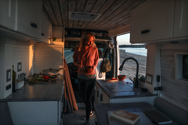 Christian Schaffer bought a brand-new Ram ProMaster in April 2019 for $36,000 and hired a team to help her build it into a livable space.