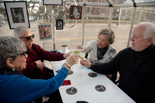 """Randy and Rochelle Forester, right, with their friends Phyllis and Sheldon Schwartz in Detroit. Ms. Forester celebrated being """"out of sweats, to put on some pretty earrings and lipstick and be back in the world a little bit."""""""