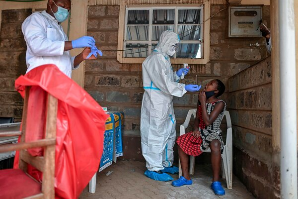 A young girl waits to be tested for coronavirus in the Kibera slum in Nairobi on October 18, 2020.