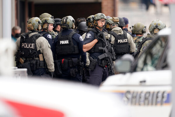 Police officers outside the King Soopers grocery store in Boulder, Colo., on Monday.
