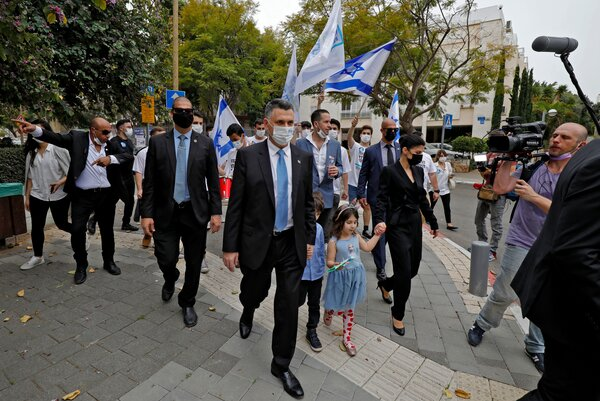 The chairman of Israel's New Hope party, Gideon Saar, and his family outside a polling station in Tel Aviv on Tuesday.