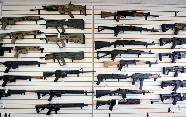 Weapons fill a wall at a gun shop in Lynnwood, Wash.
