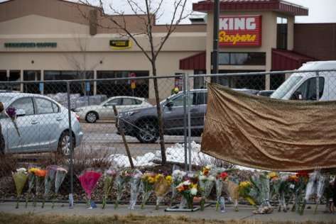 A memorial was erected near the police barricades surrounding the King Soopers store.