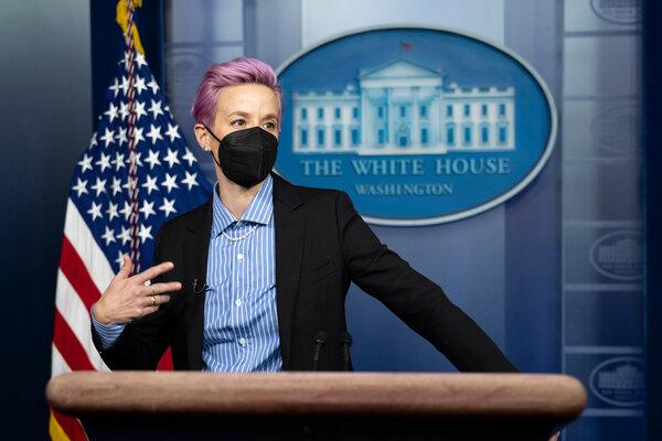 Megan Rapinoe at the podium of the Brady Press Briefing Room before meeting with President Joseph R. Biden Jr.