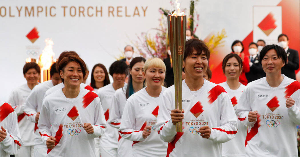 Shadowed by Pandemic, Olympic Torch Relay Begins in Japan