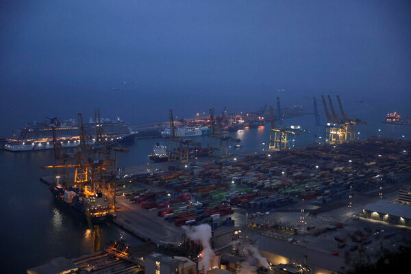 The port of Barcelona, Spain.  A two-week delay in the Suez Canal could strand a quarter of the supply of containers normally found in European ports, an expert estimated.