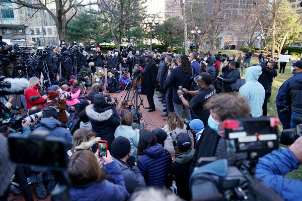 Ben Crump, a lawyer for the family of George Floyd, center, addressing the news media along with other lawyers and family members outside the Hennepin County Government Center on Monday.