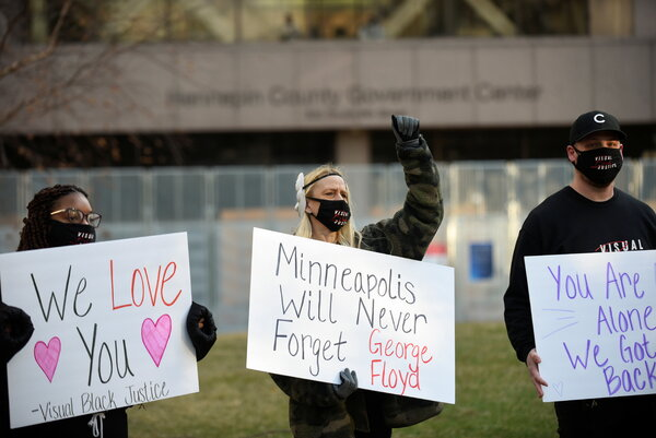 The scene outside the Hennepin County Government Center in Minneapolis during the first day of the trial of the former police officer Derek Chauvin.