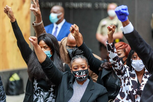 """George Floyd's family members after a court hearing in September 2020. The """"8:46"""" mask was a reference to how long Derek Chauvin was initially said to have knelt on Mr. Floyd's neck."""