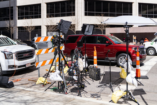 Television crews wait for news from the trial of Derek Chauvin on Tuesday.