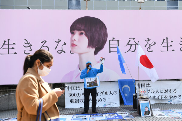 Mr. Rozi protesting China's Uyghur policies in Tokyo last month.