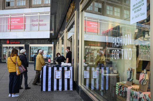 Shoppers in Berlin's Alexanderplatz. Germany and other countries have cut their value-added taxes to encourage consumer spending.