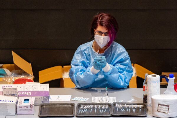 Preparing syringes with the Pfizer-BioNTech vaccine during a mass vaccination drive in Schwaz, Austria, last month.