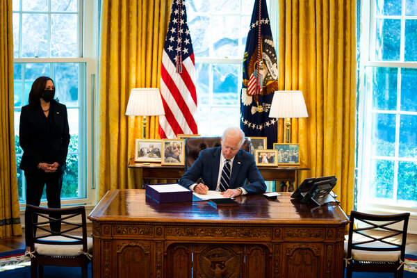 President Biden signing the coronavirus relief bill last month as Vice President Kamala Harris looked on.
