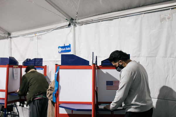 Voting in Arlington, Va., in November. Gov. Ralph Northam signed legislation this week to recreate pivotal elements of the federal Voting Rights Act that were struck down by the Supreme Court.