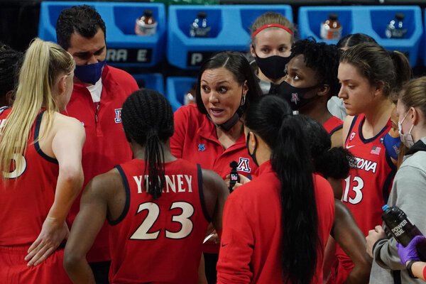 Arizona Coach Adia Barnes with her team in the second half of its semifinal against UConn.