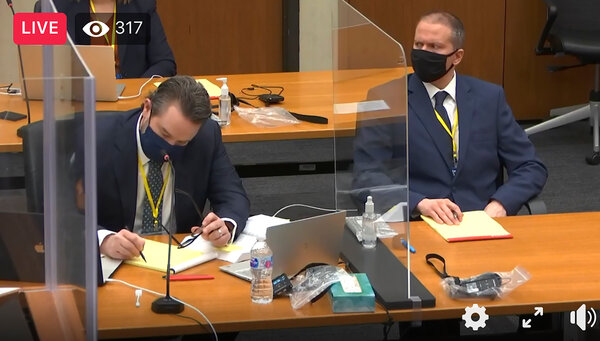 Derek Chauvin, right, and his lawyer, Eric Nelson, in a screen grab from footage that was livestreamed out of a Minneapolis courtroom on Monday.